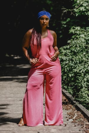 top washington dc fashion blogger wearing pink jumpsuit and blue headwrap