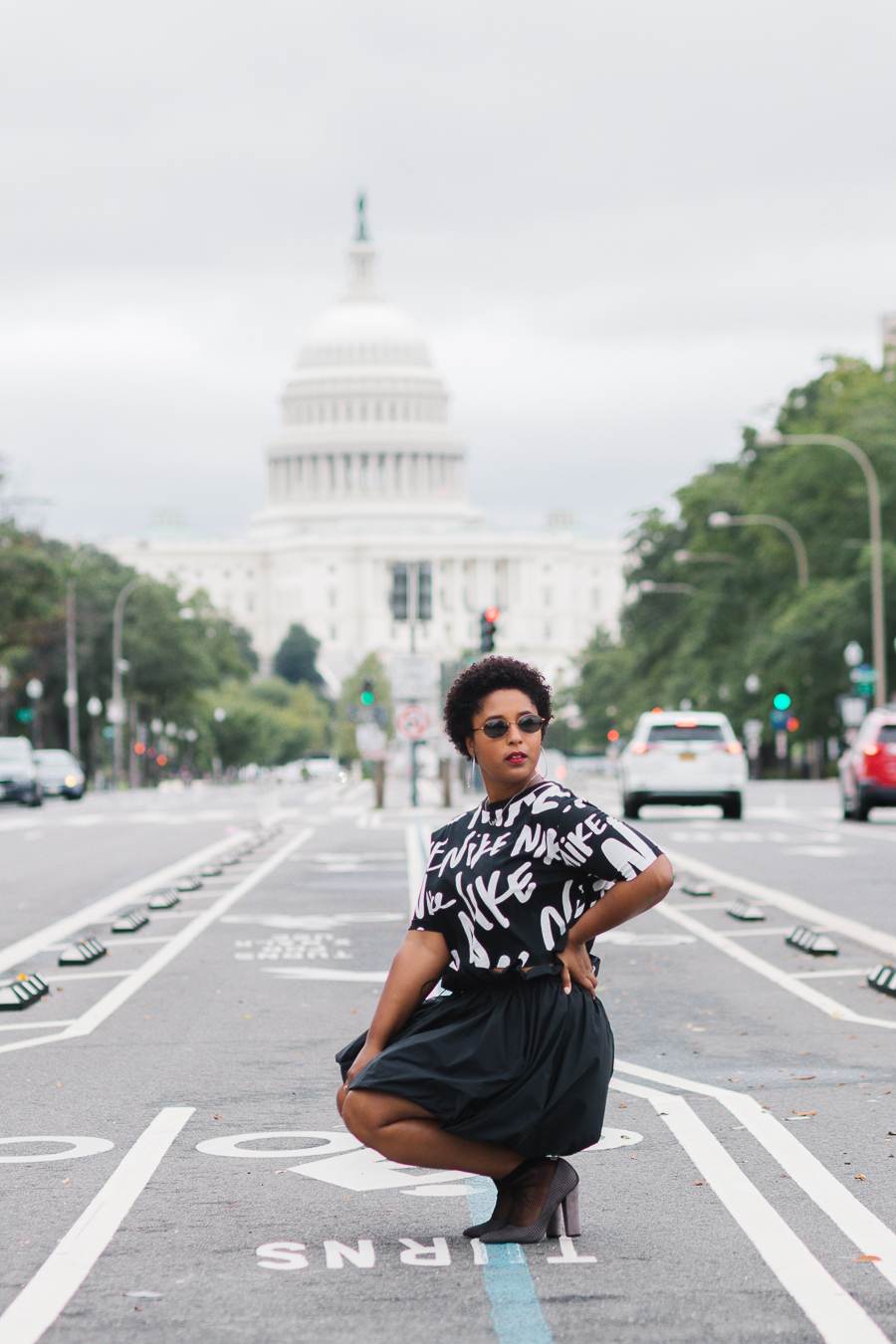 top washington dc blogger wearing nike skirt with bubble skirt street style curvy girl natural hair athleisure sporty chic